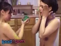 Two brunettes massage each other with food
