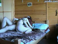 Amateur couple having sex on bed