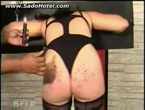 Slave with her head and arms tied gets her ass covered with hot candlewax